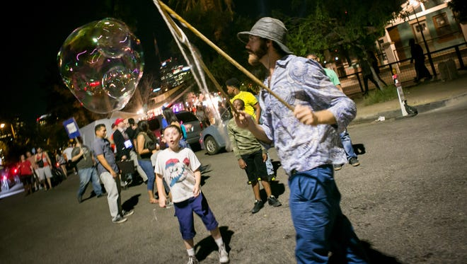 The bubble man on Roosevelt Row had lots of fans during the First Friday Art Walk on Friday, June 2, 2017.