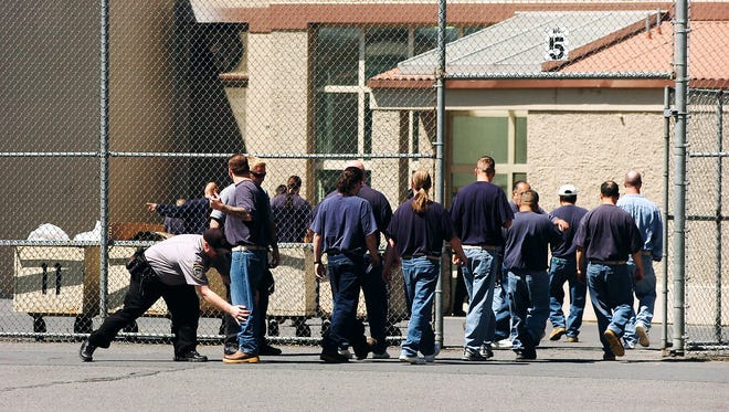 Inmates being checked at Eastern Oregon Correctional Institution in Pendleton.