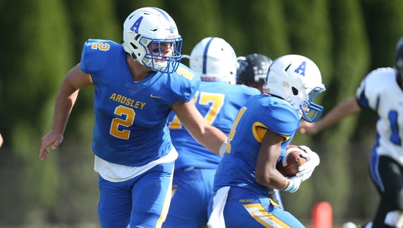 Ardsley quarterback Julian McGarvey (2) hands off to