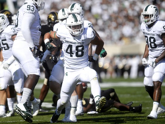 Michigan State's Kenny Willekes celebrates after he