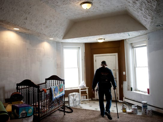 Chris Sturgill walks through the main living area of