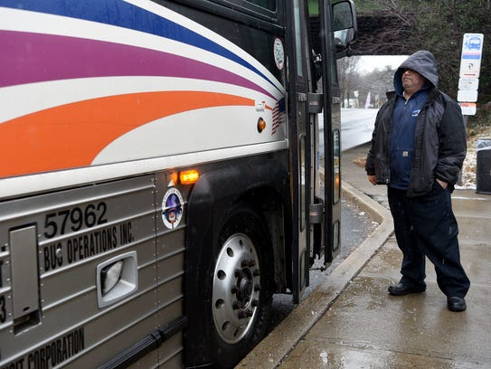 Angel Fuentes, a station starter for NJ Transit, monitors buses at the Allwood Road Park & Ride in Clifton on Wednesday, March 7, 2018.