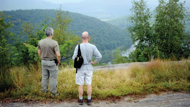Hikers at Harriman State Park in New York. Conservationists want to connect the park to Ramapo Reservation in New Jersey by purchasing key tracts of land.