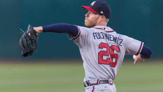 Atlanta Braves starting pitcher Mike Foltynewicz (26) pitches to the Oakland Athletics during the first inning at Oakland Coliseum.
