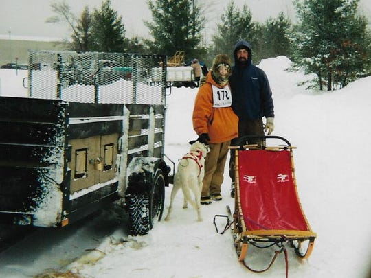 Shaynee Traska and her father, Scott Seipke, pose for a photo before her first-ever sled dog race, the Kalkaska Winterfest.