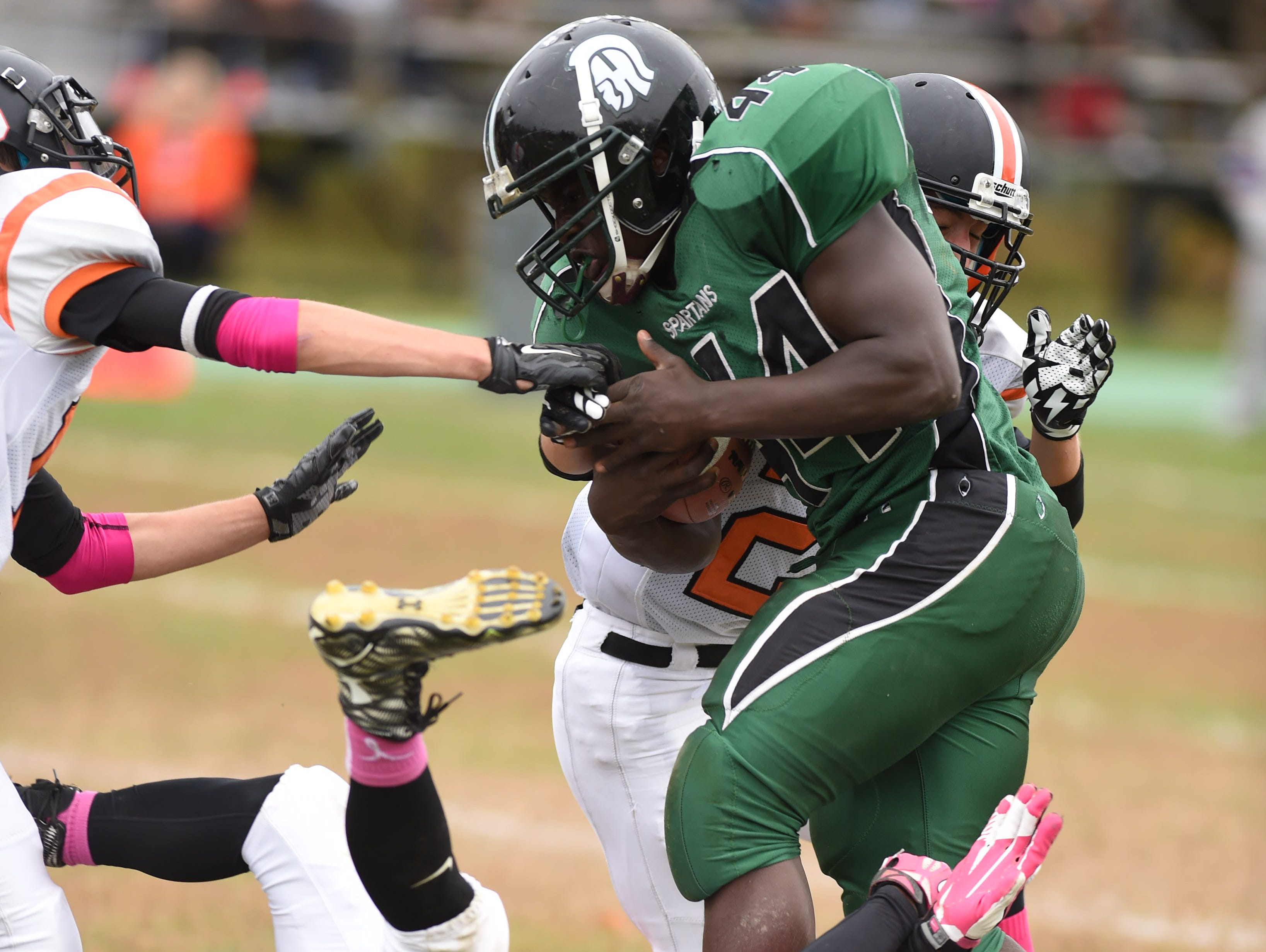Spackenkill High School's Dhyquem Lewinson is swarmed by Dover tacklers during an Oct. 24, 2015 game.