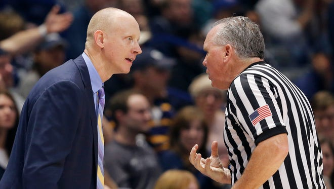 Xavier Musketeers head coach Chris Mack argues with a referee in the second half of the NCAA Big East Conference basketball game between the Xavier Musketeers and the Seton Hall Pirates at the Cintas Center in Cincinnati on Wednesday, Feb. 14, 2018. Xavier held on to its halftime lead to clench a 102-90 win over the Pirates.
