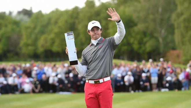 Northern Ireland's Rory Mcilroy with the trophy after he won the BMW PGA Championship at the Wentworth Club, Virginia Water, England, Sunday, May 25, 2014.
