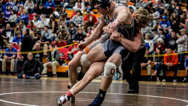 Granville junior Keegan Vanmeter, shown wrestling last year in the Heath district en route to the state tournament, finished second last weekend in his first big tourney of 2017-18.