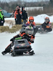 Racer Zach Ricci, 12, of Wausau, competes during the 2013 Badger State Games snowmobile racing on a race track off from Highway NN in Rib Mountain.