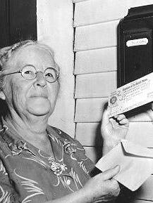 Ida May Fuller receives a Social Security benefit check.