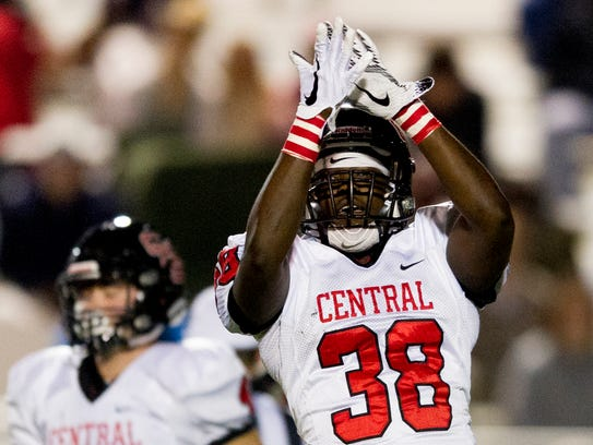 Central's Marcus Johnson (38) celebrates after making a sack against South-Doyle on Friday.