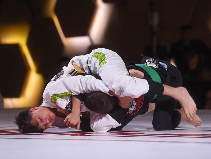 Benjamin Borja, top, attempts a triangle choke on Kristian