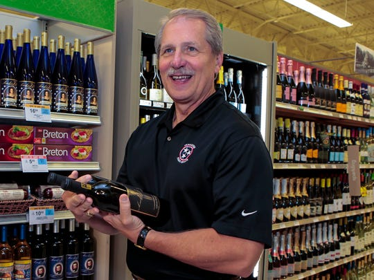Sen. Bill Ketron making the first purchase of wine