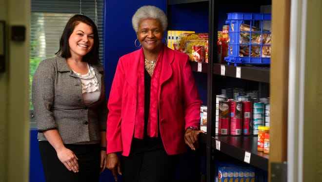 University of West Florida graduate Joelle Fondo, left, and Dr. Lusharon Wiley, senior associate dean of students, pose in the Argo Pantry. The pantry provides healthy food to currently enrolled UWF students who are in need of emergency assistance.