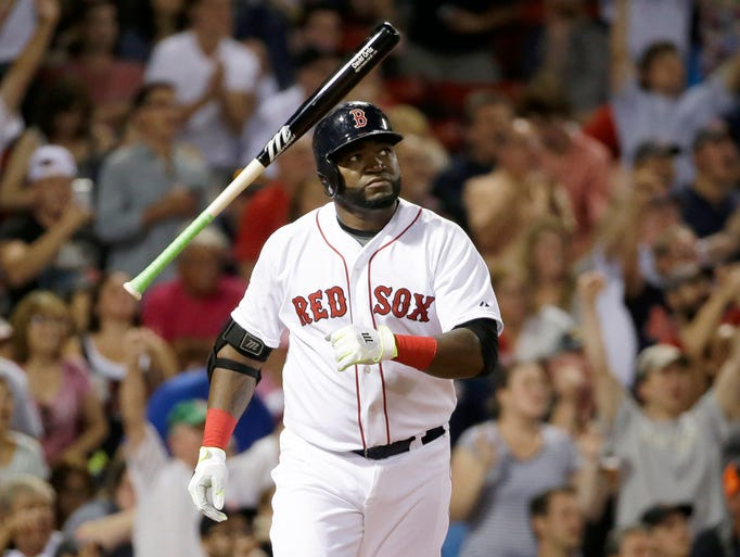 Boston Red Sox's David Ortiz tosses the bat as he watches