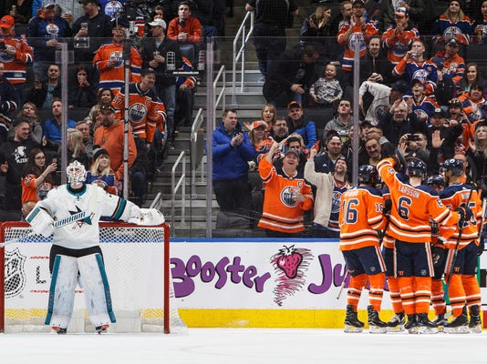 San Jose Sharks goaltender Martin Jones stand in front of the goal as the Edmonton Oilers celebrate a goal during the first period of an NHL hockey game Wednesday, March 14, 2018, in Edmonton, Alberta. (Jason Franson/The Canadian Press via AP)