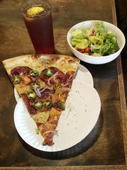At Five Points Pizza you can get a large slice of New York Pizza, a nice salad ( I like the Greek salad) and a drink for $9 at lunchtime .
