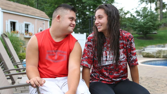 Robbie Alonso, 16, and Victoria Alonso, 17, in their yard in Stony Point, Sept. 1, 2016. The siblings lost their mother, Janet Alonso, in the September 11 attacks. Robbie has played in the Red RaidersÕ basketball program and has future plans to participate in the Special Olympics and Victoria recently committed to play Division I softball for Manhattan College.