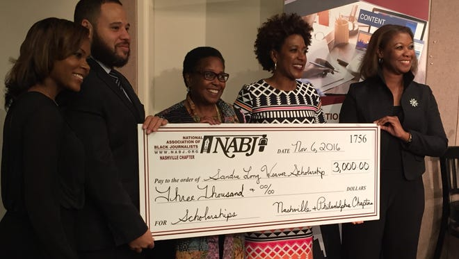 NABJ national founder Sandra Long Weaver (center) is presented a check showing the amount for the scholarship named in her honor. (L-R) Others in the photo are NABJ Nashville Vice President Hayley Mason and President Jason Luntz and Scholarship Reception Planning Committee Co-chairs Dr. Sybil Brown and K. Dawn Rutledge.
