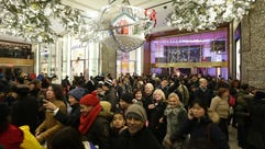 Shoppers come through the doors at Macy's Herald Square