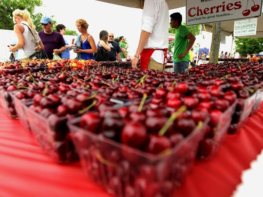 Cherries from Edmondson Orchards are sold near the Open Space during the opening day of the National Cherry Festival in Traverse City, Mich.