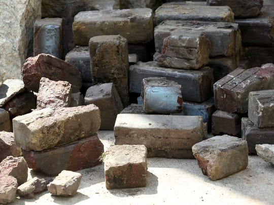 Historical bricks that Waller gathered after they were removed from Adrian Alley.