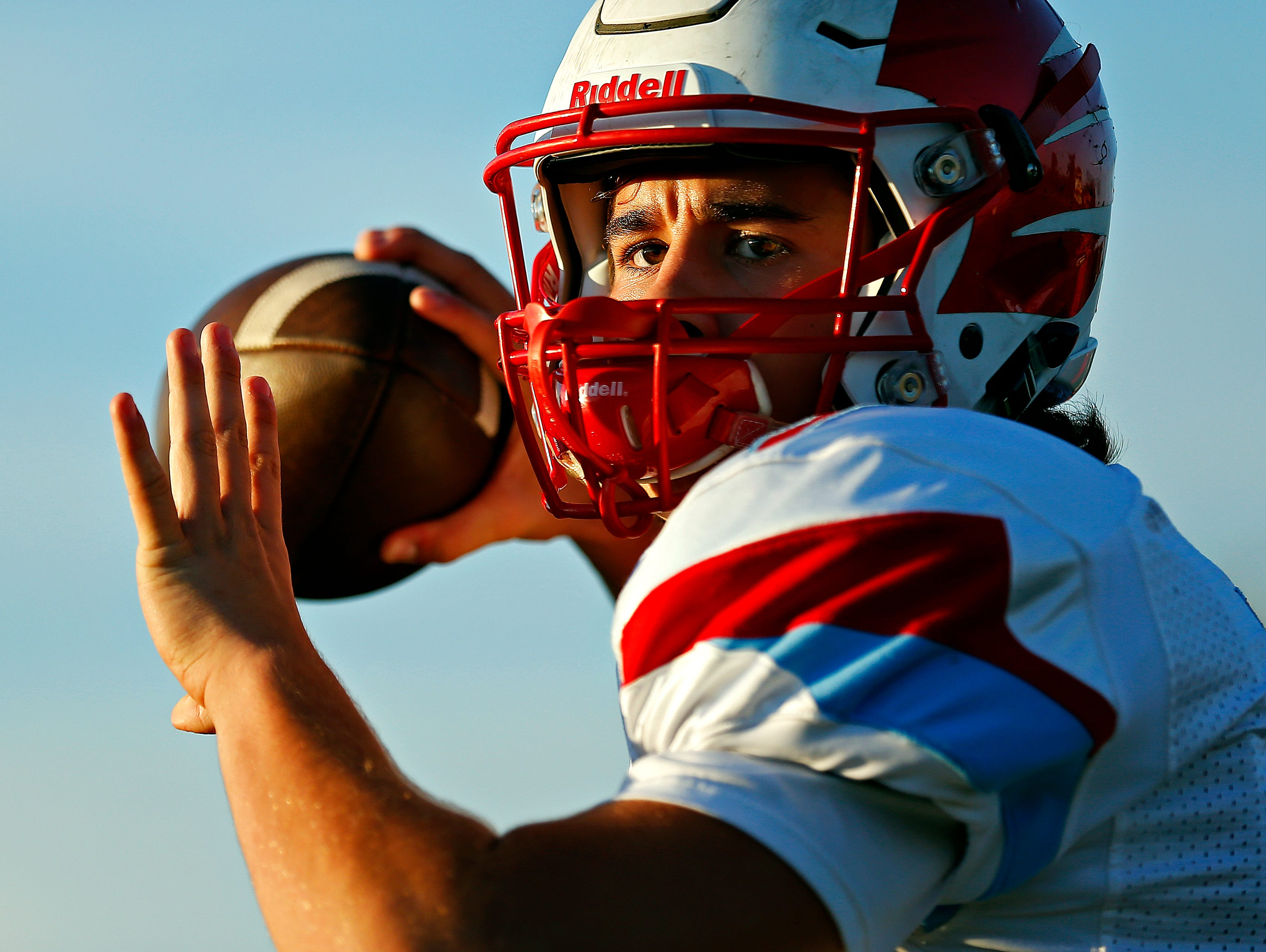 Glendale High School quarterback Alex Houston (7) warms up prior to the start of the football game between Glendale High School and Parkview High School at JFK Stadium in Springfield, Mo. on Sept. 22, 2016.