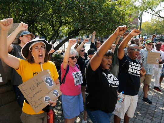 People raise their fists during Black Lives Matter: