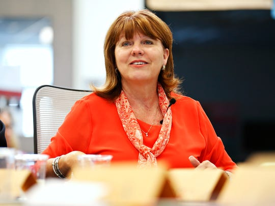 Board member Denise Fredrick participates in a conversation about school facilities.