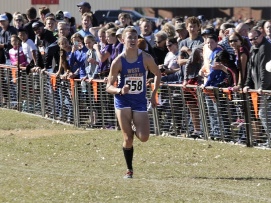 West Central's Derick Peters sprints to the finish line during the Class A boys state cross country meet Saturday at Broadland Creek Golf Course in Huron. (Marcus Traxler/Mitchell Daily Republic)
