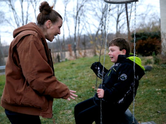Heather Jones plays with her son, Gage, 8, at their