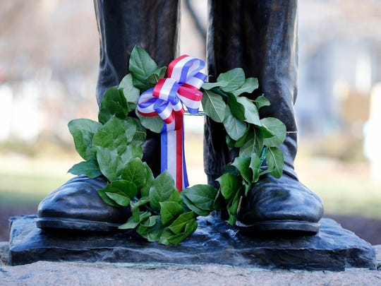 A wreath to honor the Feb. 12 birthday of Abraham Lincoln, lays at the statue in Lytle Park.