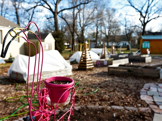 A flamingo decorates the garden source for the Delaware Community Garden in Springfield, Mo. on Feb. 23, 2017.