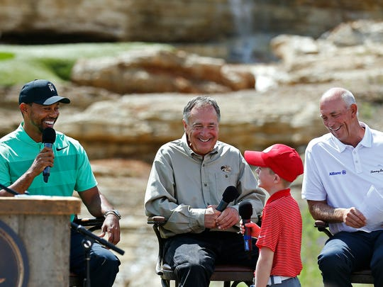 Professional golfer Tiger Woods (left) and Bass Pro