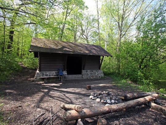 Shelter #3 (the Dundee Shelter) off the Ice Age Trail in the Kettle Moraine State Forest includes sleeping benches inside the shelter and a bench, stone fire ring and vault toilet (not pictured) outside.