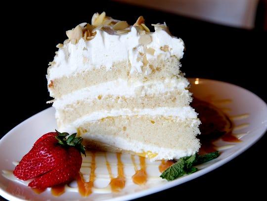 Limoncello cream cake with layers of vanilla cake drizzled
