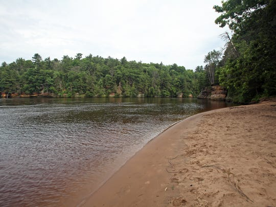 A trail leads to a sandy beach at the Dells of the Wisconsin River north of Wisconsin Dells.