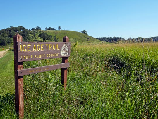 The 2.5-mile Table Bluff segment of the Ice Age Trail travels through restored prairie and past dolomite rock formations.