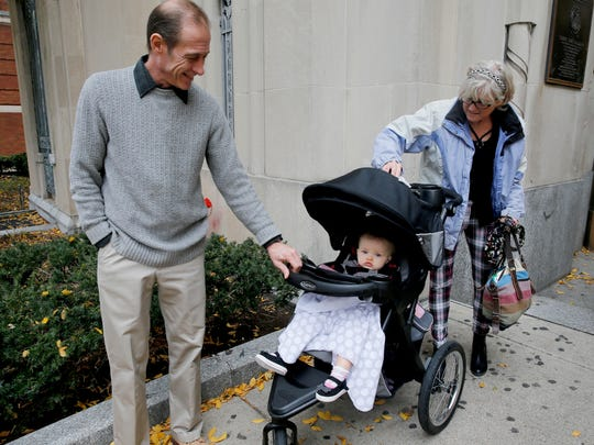 "Joe and Beth Arcail of Bethel walk out of Hamilton County Juvenile Court Dec. 3 after obtaining permanent custody of granddaughter Elliana Russ, 1. The baby's mother, Stephanie Gaffney, died at 28 in July from a fatal opioid overdose. The Arcails said they aim to ensure the baby's father, Stephen Russ, stays in her life: ""She's already lost her mother,"" Beth Arcail said. ""We don't want her to lose her father."""