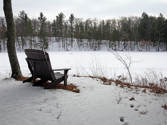 An Adirondack chair provides a spot for resting along