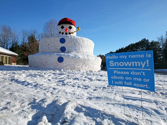 A sign in front of Snowmy Kromer asks visitors to stay off the 30-foot-tall snowman in front of the Minocqua Area Chamber of Commerce, shown on Feb. 16, 2018.