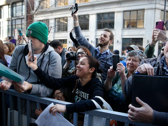 Fans try to get a glimpse of Mark Wahlberg his family's new restaurant Wahlburgers in Downtown Monday February 26, 2018.