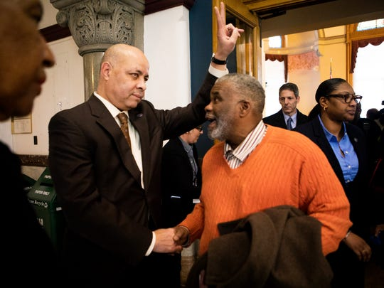 Cincinnati City Manager Harry Black, talks with Freeman McNeal at City Hall Wednesday, March 14, 2018.