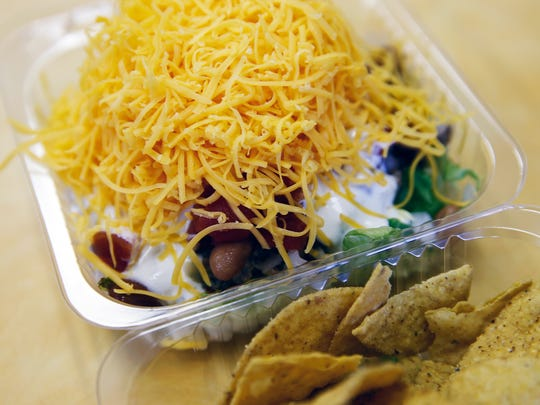 The taco salad with ground turkey, pinto beans, buttermilk ranch topped by cheddar cheese by Taco Casa in Norwood. The restaurant  is celebrating 50 years. Photo shot Wednesday March 28, 2018.. Photo shot Wednesday March 28, 2018.