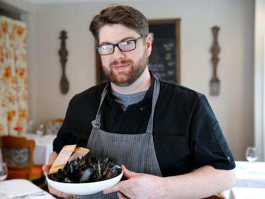 Eric Polhamus, executive chef of La Petite Pierre, 7800 Camargo Road, Madeira. Monday April 9, 2018.