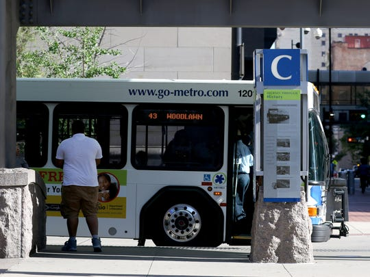 Passengers load Metro buses at Government Square Thursday June 14, 2018.
