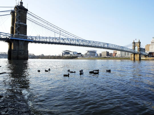 The Roebling Suspension Bridge spans 1,057 feet across