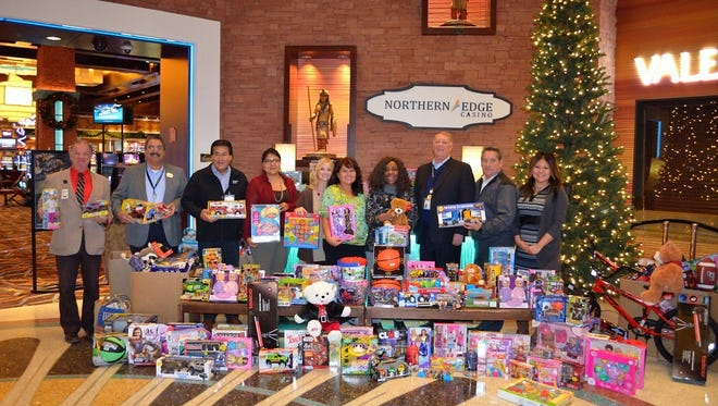 Staff from Northern Edge Casino, Flowing Water Casino and Ojo Amarillo Elementary School pose with donated toys. Northern Edge Casino and Flowing Water Casino held their annual toy drive from Dec. 8 to 9 and collected a record 503 toys. The toys will be donated to Ojo Amarillo Elementary School in Upper Fruitland, and the school will hand them out to students before the holiday break. Pictured from left are Charles Evans, shift manager for Northern Edge Casino and Flowing Water Casino; Jose Tronsoco, director of security for the casinos; Neil Johns, director of facilities for the casinos; Lynnlaria Dickson, pre-school teacher at Ojo Amarillo Elementary; Sheri Eddleman, librarian at the school; Charlene Tyler, receptionist at the schools; Steve Penhall, general manager of the casinos; Paul Aragon, director of food and beverage for the casinos; and Shanta Pioche, executive administrative assistant for the casinos.
