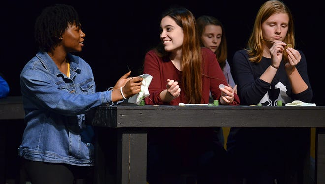 Marjorie Tubie, Renata Terrazzan and Maddy Strong rehearse a scene from Walled Lake Central's production of Radium Girls.